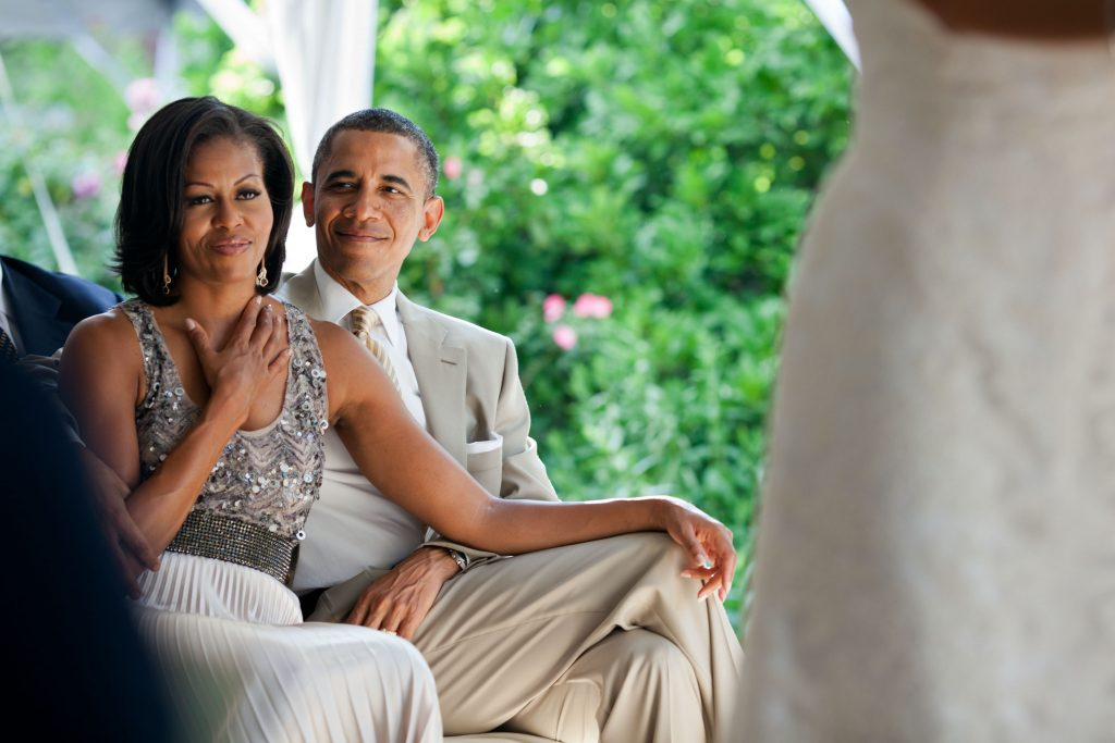 Barack and Michelle at a wedding
