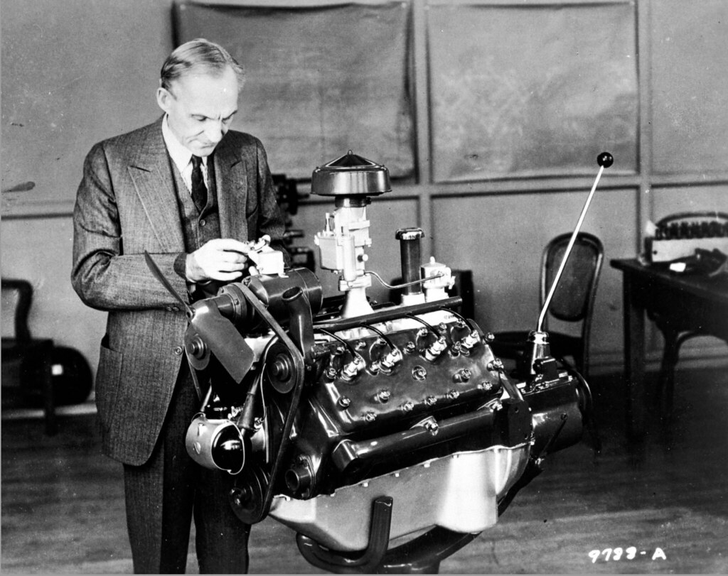 Henry Ford looking at engine