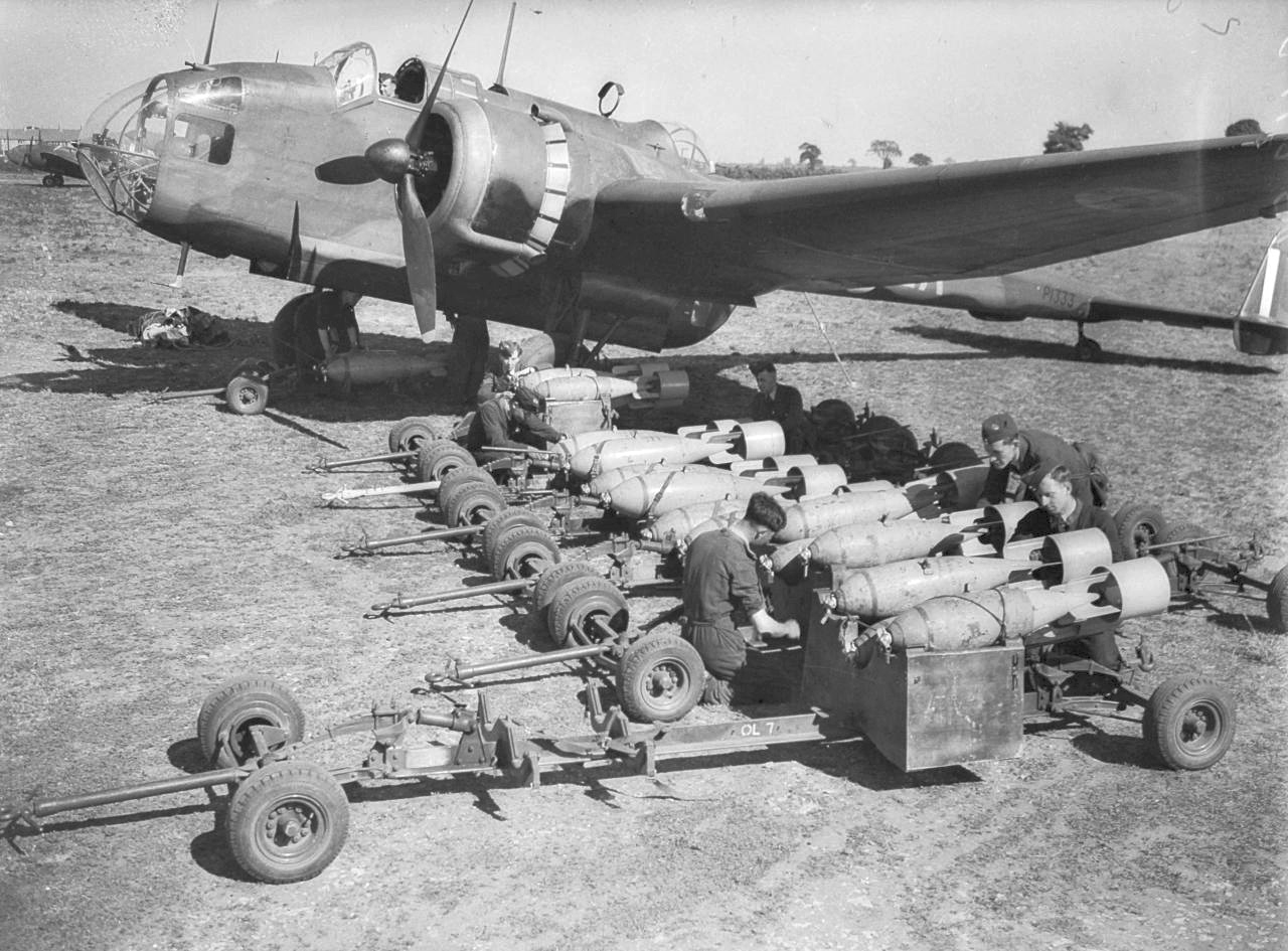 Loading bombs onto a World War II plane