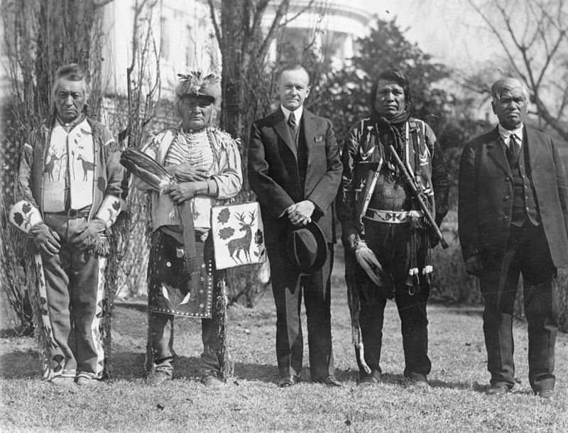 President Coolidge Stands With Four Osage Indians At A White House Ceremony
